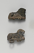 Two silver clasps with lions