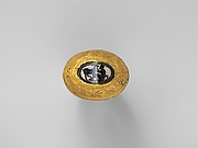 Banded agate intaglio set in a large gold ring