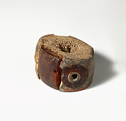 Ivory and amber segment from a bronze fibula (safety pin)