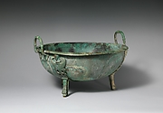 Bronze handled basin with three feet
