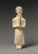 Limestone flute-player