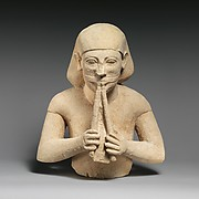 Limestone bust of a flute-player