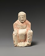 Limestone statuette of a seated female figure