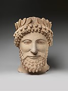 Limestone head of a bearded man wearing a wreath