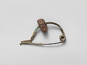 Bronze fibula (safety pin) with amber segment