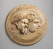 Marble disk with two theater masks in relief