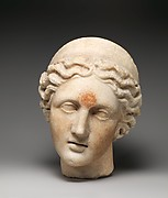 Marble head of a goddess wearing a diadem