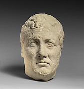Limestone head of beardless male votary