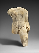Limestone figure of a draped man
