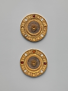 Pair of gold and rock crystal disks, set with garnet and glass inlays