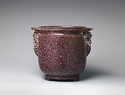 Porphyry vessel with bearded masks