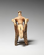Terracotta figure in an armchair