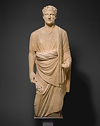 Limestone statue of a young man