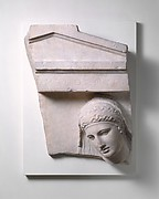 Fragment of a marble grave stele of a woman