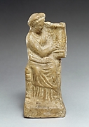 Terracotta statuette of a seated woman playing a kithera
