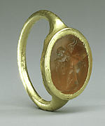 Gold ring with carnelian intaglio: Eros with flaming torch