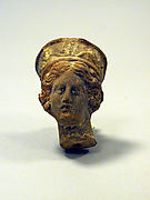 Head of a woman from a statuette