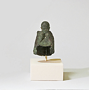 Fragmentary bronze statuette of boy wearing a mantle