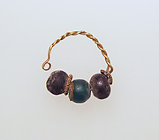 Gold earring with glass beads