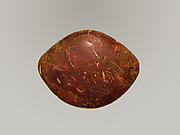 Amber from bow of a bronze fibula (safety pin)