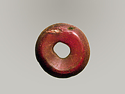 Pierced disk, perhaps from an earring or fibula (safety pin)