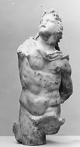 Marble statuette of a male figure with shaggy hair