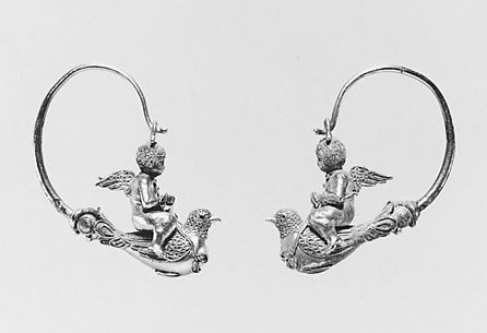 Pair of gold hoop earrings with Erotes riding doves