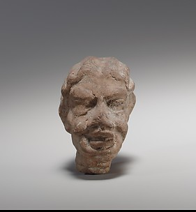 Terracotta head of an old woman
