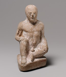 Terracotta statuette of a seated boy