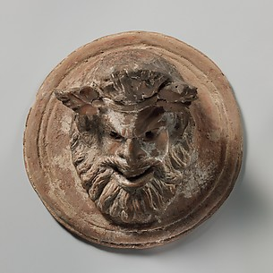 Terracotta roundel with mask of Pan