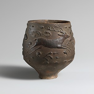 Terracotta cup with barbotine decoration