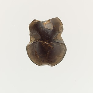 Obsidian bead in the form of of a figure-of-eight shield
