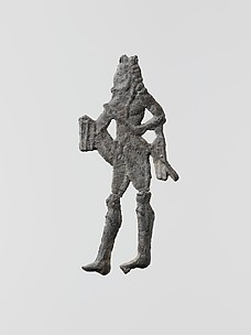 Lead figure of a man with a spear or scepter
