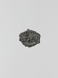 Lead ornament in the form of a gorgoneion (gorgon's face)