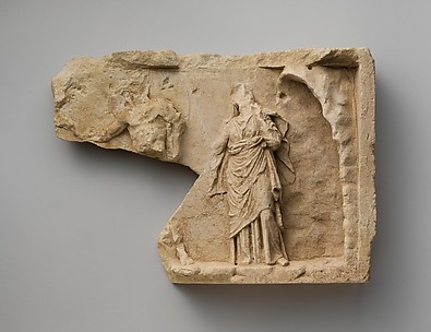 Fragment of a limestone relief with two standing figures