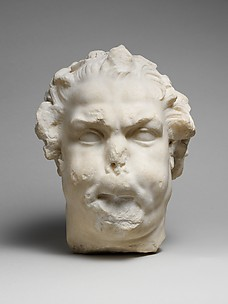 Marble head of a satyr playing the double flute
