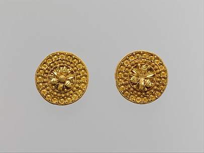 Gold disks with floral motifs and lions' heads