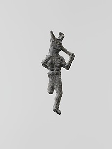 Lead figure of a flute-player