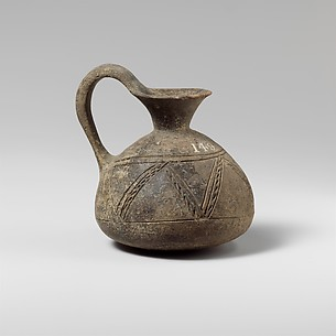 Terracotta jug with incised decoration