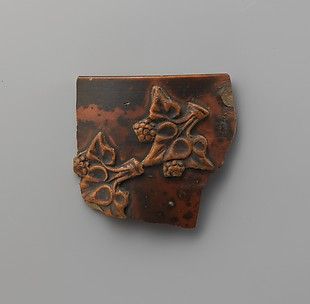Terracotta applique fragment of ivy leaves and berries