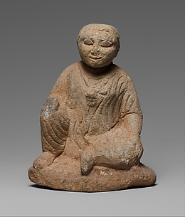 Limestone statuette of a seated temple boy on an inscribed base