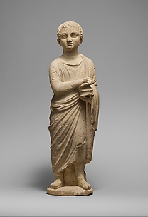 Limestone statue of a youth holding a pyxis