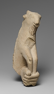 Limestone statue fragment of a left hand holding a kid