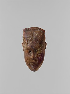 Pendant: head of a woman
