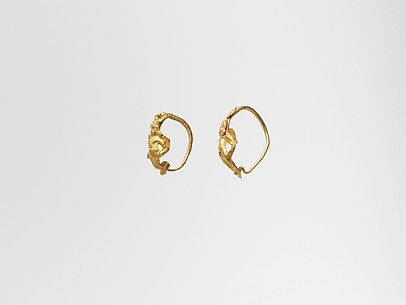 Gold earring with winged figure