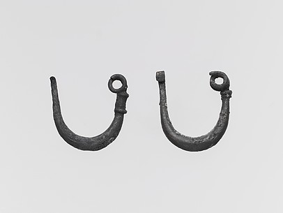 Two silver fibulae (safety pins)