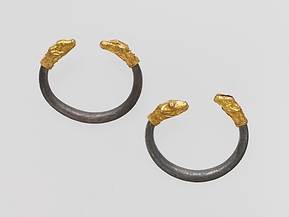 Silver bracelet with gold calf's head finial