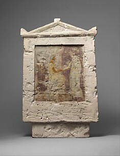 Painted limestone funerary stele with a seated man and two standing figures