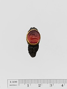 Carnelian ring stone with gold band set in a silver ring