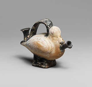 Terracotta askos (flask with a spout and handle over the top) in the form of a duck